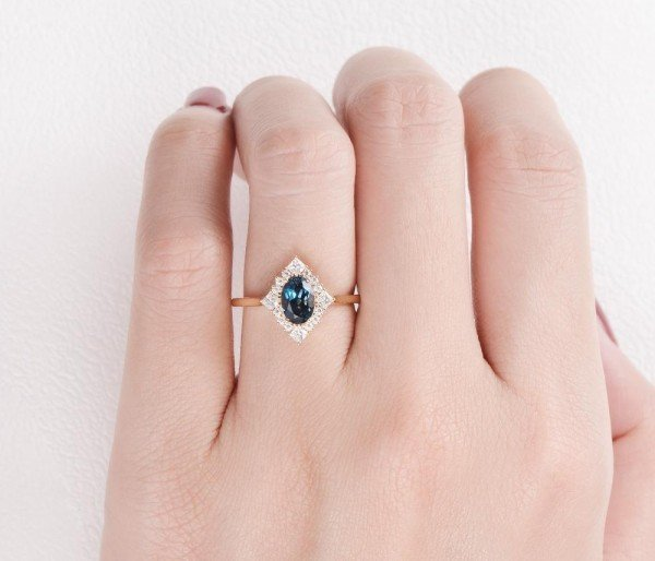 Oval Blue Topaz Vintage Halo Ring - Finger