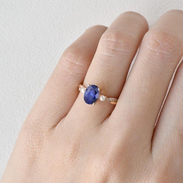 Oval Shaped Sapphire Trinity Twist Ring - Finger