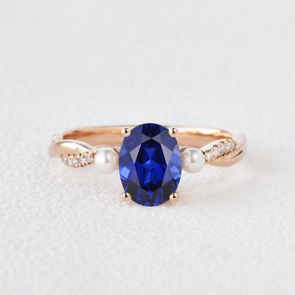 Oval Shaped Sapphire Trinity Twist Ring - Front