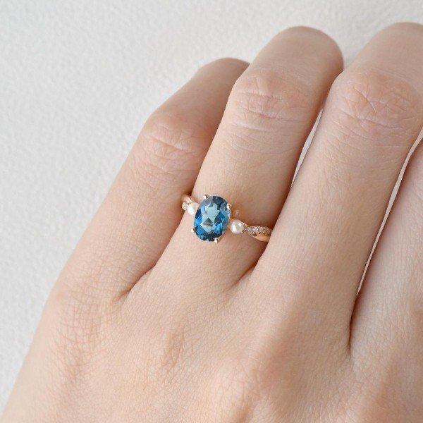 Oval Shaped Blue Topaz Trinity Twist Ring - Rose - Finger
