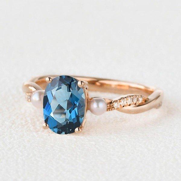 Oval Shaped Blue Topaz Trinity Twist Ring - Rose - Side