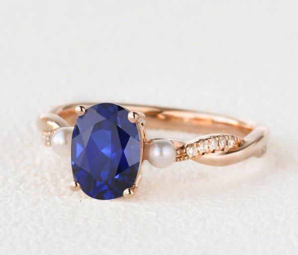Oval Shaped Sapphire Trinity Twist Ring - Side