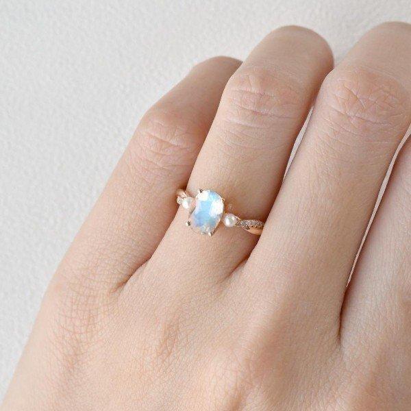 Oval Shaped Moonstone Trinity Twist Ring - Finger